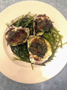 We also had Oysters Rockefeller, one of my favorites. Oysters Rockefeller consists of oysters on the half-shell that have been topped with a rich sauce of butter, parsley and other green herbs, and bread crumbs, then baked or broiled.