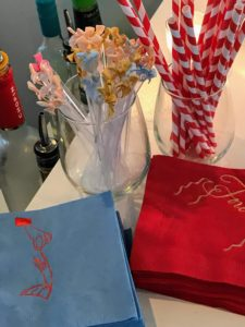 "Other favors included decorative drink stirrers, foil stamped napkins with a ""ring on finger"" motif throughout."