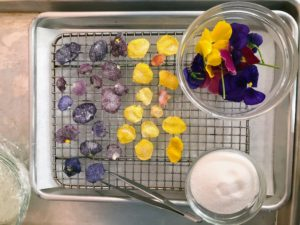 You can easily use candied flowers to embellish any dessert you like - it's so easy - just use egg whites, water, sugar and flower petals.