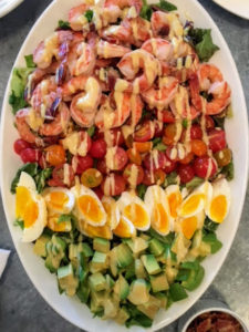 For lunch one day, we had this shrimp cobb salad. We poached the shrimp in water with aromatics to give them flavor and added eggs, and lots of cherry tomatoes from my garden.
