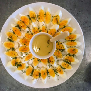 This is a classic French lunch dish. Perfectly cooked eggs seasoned with flaky sea salt, black pepper and chives, then drizzled with a Dijon vinaigrette.