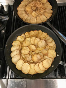 We also had pommes d'anna. Chef Molly sliced potatoes on the mandolin and shingled them in concentric circles and brushed them with clarified butter between layers. Then she seasoned them with salt and pepper and baked them until golden brown.