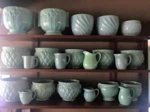 And, I have wall shelves to hold and display more teal McCoy pottery jardinieres and pitchers.