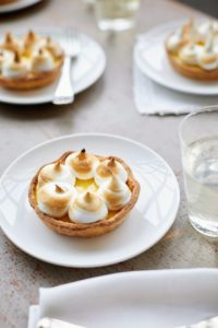 These tarts have easy press-in crusts that are filled with a citrusy custard. Gilded with gorgeous piped swirls of meringue, they're guaranteed to be a hit at any gathering.