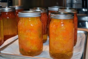 Remove the jars and place them on the counter to continue cooling - look at the beautiful bright colors of these orange tomatoes. I like to leave them for 24-hours. After several hours, check that each lid is concave. If the lid pops back, it is not sealed and will have to go through the process again.