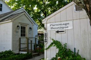 Next door is the Red Barn's other building called the Parsonage Boutique, where most of the clothing items are displayed for visitors.