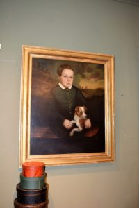 Here is a folk art portrait of a boy and his dog from the early 1800s.