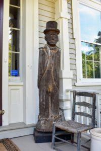 The gallery is housed in a classic Greek revival home. This handsome wooden figure sits by the front door.