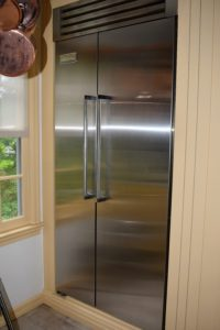 "This unit is in another kitchen - you may recognize it - it is in the same kitchen where I shot a recent season of ""Martha Bakes"" for PBS. This is a residential refrigerator/freezer unit with the fridge on one side and freezer on the other."