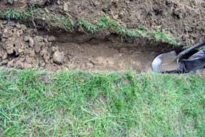 The crew began digging a trench that was about two-feet deep and about a foot-and-a-half wide.