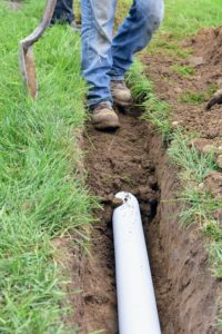 And then gently walked on to pack in the soil around the pipe and level the earth.