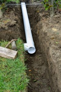 The crew lined more pipe along the trench building intersections and elbows wherever necessary.