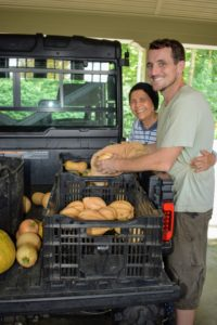 My longtime housekeeper, Laura Acuna, loves squash and came out to see all the varieties in this year's bounty. Ryan wipes down every fruit with a damp towel to cut down the risk of rot during storage.