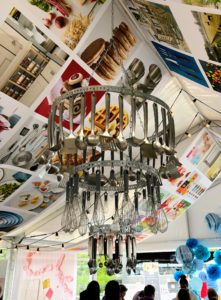 Above the table – a Macy's gadget chandelier made with handy kitchen supplies also from my collection exclusively at Macy's.