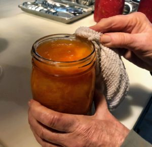 And be sure to wipe the rims of the the jars with a clean damp cloth. It is important to make sure there are no seeds or bits of flesh on the rims that could prevent the seals from forming.