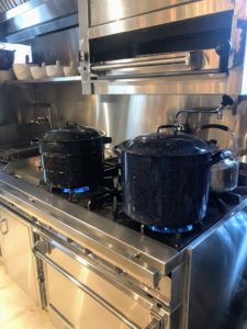The jars must remain covered with water throughout processing time. Once done, turn off the heat and wait a few minutes before removing the jars. As they cool, you may hear the lids ping, which is a sign that vacuum sealing has occurred.