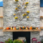 Above the mantel, we dressed this Metal Wall Tree with sunflowers and pumpkins.