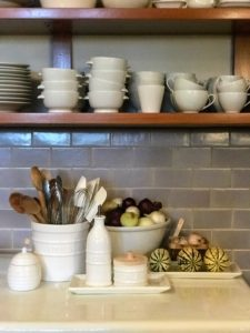 "If you follow my blog regularly, you may recognize my ""Great Wall of China"" where I store all my everyday white pieces in my Maine kitchen. These ceramic containers for kitchen tools, oil, salt and sugar from my Farmhouse Collection look like they've always been there."