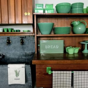 The colors I choose for all my pieces are always inspired by things I love. My Farmhouse Collection herb dishtowel coordinates perfectly with the green Jadeite dishes and the vintage breadbox.