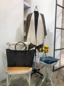 Here is a closer look at the Canvas Tote with Leather Trim. These totes are perfect work bags - I use one every day. It measures 23 and a half inches by 14-inches by just under eight-inches deep with handles.