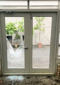 I have several doorways into this vegetable greenhouse. Here is one of two broken double doors. Each door is fitted with a double paned, tempered and insulated glass unit - only one pane from each door was broken.