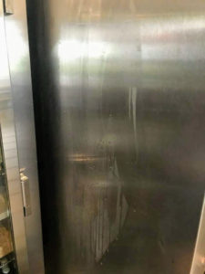 When Scott pulled out the freezer, it was easy to see condensing water along the outside of the cabinet.