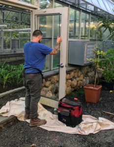 Here, Ian is placing the other glass unit back onto the door frame.