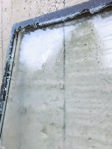 """Here is the glass completely removed. The black rubber coating around the glass is called """"butyl"""" and is used to seal the two panes of glass together and prevent moisture in the air from getting between the two units."""