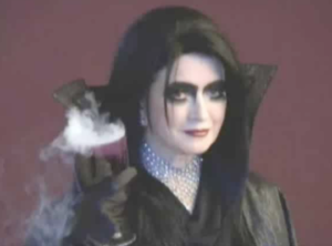 """And here I am as a creepy """"Glampire"""", complete with my dramatic black cape made from black silk and woven with metallic threads. I wish you all a frightfully fun Halloween. Enjoy my ideas and tips for this and every season on the new MarthaStewart.TV App!"""