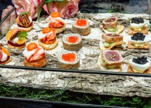 PS Tailored Events made and served all the delicious appetizers, including deviled quail egg with caviar, marinated salmon on buckwheat crepes and salmon roe, seared sesame tuna, and lobster medallion on toasted brioche with saffron aioli. (Photo by Benjamin Lozovsky for BFA)