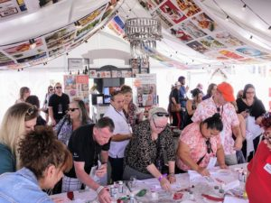 In another section of the Pavilion, guests lined up to join in on craft projects at the Michael's table. Lots of volunteers were on-hand to help visitors make personalized aprons using Martha Stewart Craft Paints.