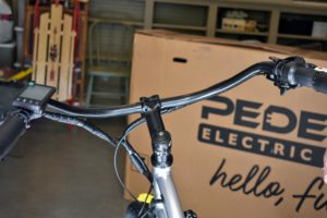 He adjusts the bolts so they are just tight enough to allow proper steering without making it feel rigid and sluggish. Pedego bikes have wide, swept back handlebars that allow for good posture and a relaxed ride.