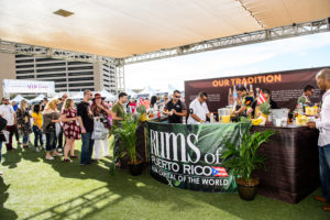 """Visitors lined up to sample some of the """"Rums of Puerto Rico"""" such as Bacardi, Don Q, Ron del Barrilito, Ron Llave and Palo Viejo. (Photo by Brenton Ho for MGM Resorts International)"""