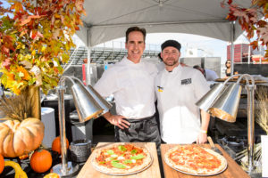 Everyone flocked to the Five50 Pizza Bar tent to try out the delicious pizza. James Beard Award-winning chef, Shawn McClain, and his team personally served up slices for guests. https://www.aria.com/en/restaurants/five50.html (Photo by Brenton Ho for MGM Resorts International)