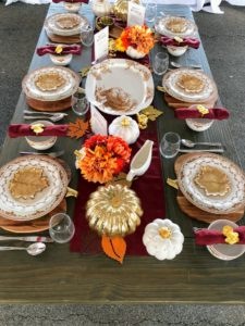 """In the center of the Pavilion is a table dressed with pieces from my """"Sepia"""" and """"Harvest"""" Collections exclusively at Macy's - my Sepia dinnerware and turkey platter, my leaf plates and Harvest serveware. Order these great pieces for the holidays - they'll be here before you know it. https://www.macys.com/shop/dining-entertaining/martha-stewart-dining?id=30213"""