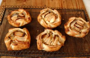 Rustic Apple Tarts: Take advantage of the last days of apple season with these free-form tarts filled with both apples and applesauce, no pie or tart pans required. I demonstrate how to make homemade apple sauce, but in a pinch, you may use a good-quality prepared brand.