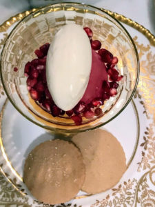 Pierre uses some of the fresh pomegranate seeds to garnish the cup of sorbet.