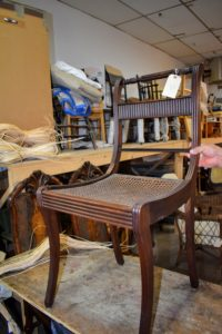 Here is one of two antique dining chairs that needed repair. Chair seat weaving, and especially chair caning was popular in South East Asia, Portugal, France, and England in the mid-1600s and extensively practiced through the 1700s,1800s and on into the early 1900s.