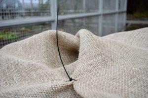 Pete uses a couple of cable ties to keep the burlap together as he works.