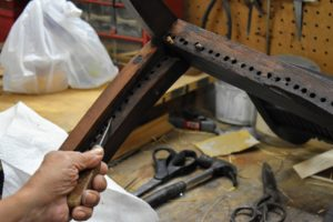 Danny checks every hole of the chair from the top and from the bottom to be sure all the old cane is removed.