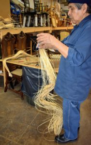 Caning material comes in bunches of long strands and is extremely flexible and uniform in thickness. Dany removes a few strands and soaks them in warm water for about five-minutes.