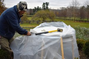 Because stone and cement can crack from exposure to the winter elements, Pete covers the entire fountain with another piece of heavy duty plastic. Rolls of this plastic can be ordered online or purchased at local hardware and home supply stores.