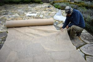 Pete cuts the burlap fabric to fit – one long piece that can completely wrap around the fountain.