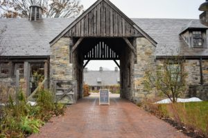 A welcoming sign at the entrance points the way to the Stone Barns Market. Built in the 1920s by John D. Rockefeller as his dairy barns, the complex was later converted into Stone Barns by his youngest son, the late David Rockefeller.