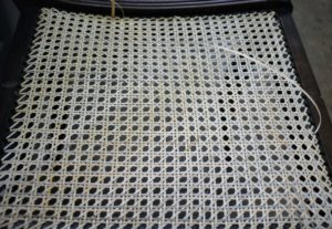 Here is the seat with more than half of the diagonal strands complete.