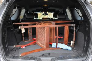 They're carefully picked up and returned to the farm just days before Thanksgiving. When transporting any furniture, be sure to secure them well so they don't get damaged during the ride. These chairs were tied down with cords so they did not move or hit each other.