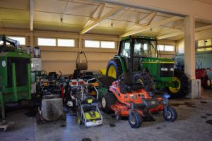 Mowers, blowers, tractors, tillers and generators are all parked on one side of the Equipment Barn. We park them faced out, so they are easy to get to and to move when needed. The John Deere tractor on the right is great. It is often used for mowing the hay fields.