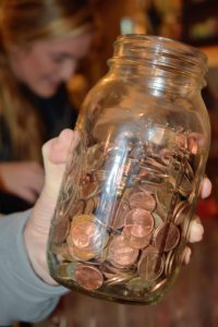 As the bags were being filled, I came down with a jar of saved pennies - I wanted to add a few into each bag. It's a great way to get rid of all those pennies, while offering something a bit more valuable than candy.