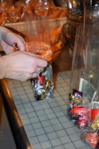 Then, Shqipa tied the decorative orange ribbons to the tops of each bag.