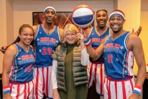 And look at this fun photo of me spinning a ball on my finger - with a little help from Globetrotter, Cheese Chisolm. Also in this photo are Ice Hrynko, Hi-Lite Bruton and Thunder Law. We had a great time. If you're in New York City when the Globetrotters are playing, I encourage you to go - you'll love it. (Photo courtesy of Harlem Globetrotters)